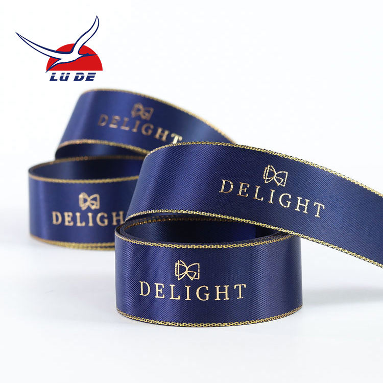OEM factory high quality custom logo gold foil printed blue satin ribbon roll with gold edge