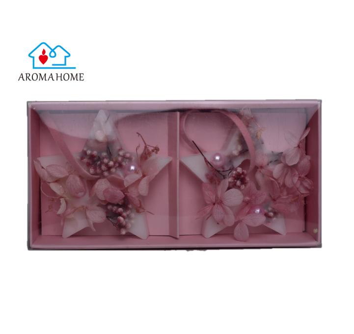 Two star shape wax melt with dried flower and pink pearl packaged in pink gift box