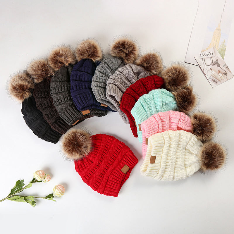 Wholesale colorful custom logo winter unisex women knitted pom pom fur beanie hat