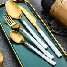 Stainless steel cutlery includes spoon fork knife with golden handle and bark texture design flatware