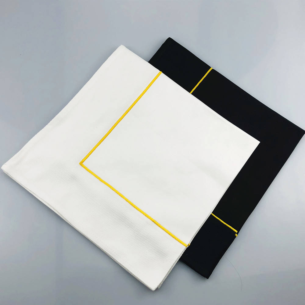 100% cotton white and black napkin with jacquard frame and gold embroidery
