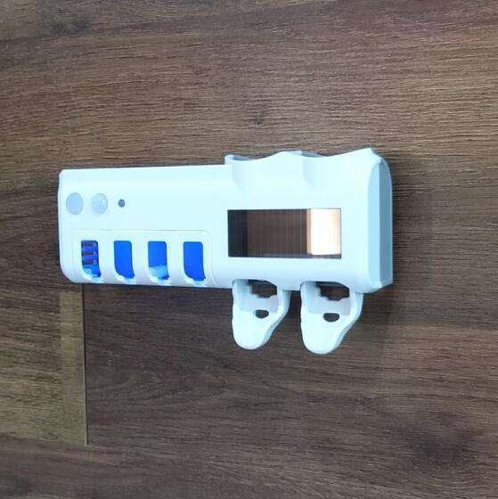 UV toothbrush sterilizer and toothpaste dispenser