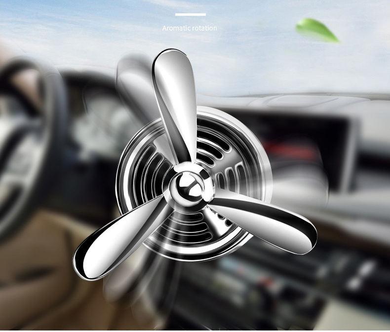 車の空気清浄アロマソーラー回転高級香水車両ディフューザー
