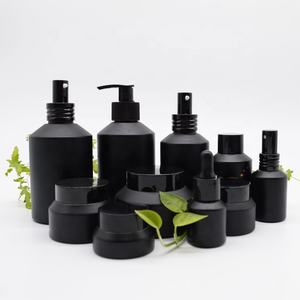 unique design slanted shoulder recyclable cosmetic glass bottles and jars for skin care packaging
