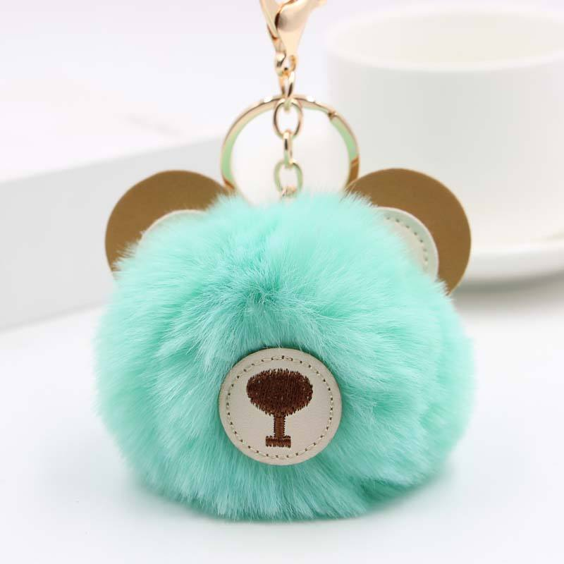 Factory Direct Sales pompom fur puff ball keychain projector