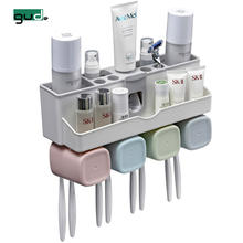 luxury home bathroom plastic accessory set automatic toothpaste squeezer tooth paste dispenser holder with Toothbrush Holder