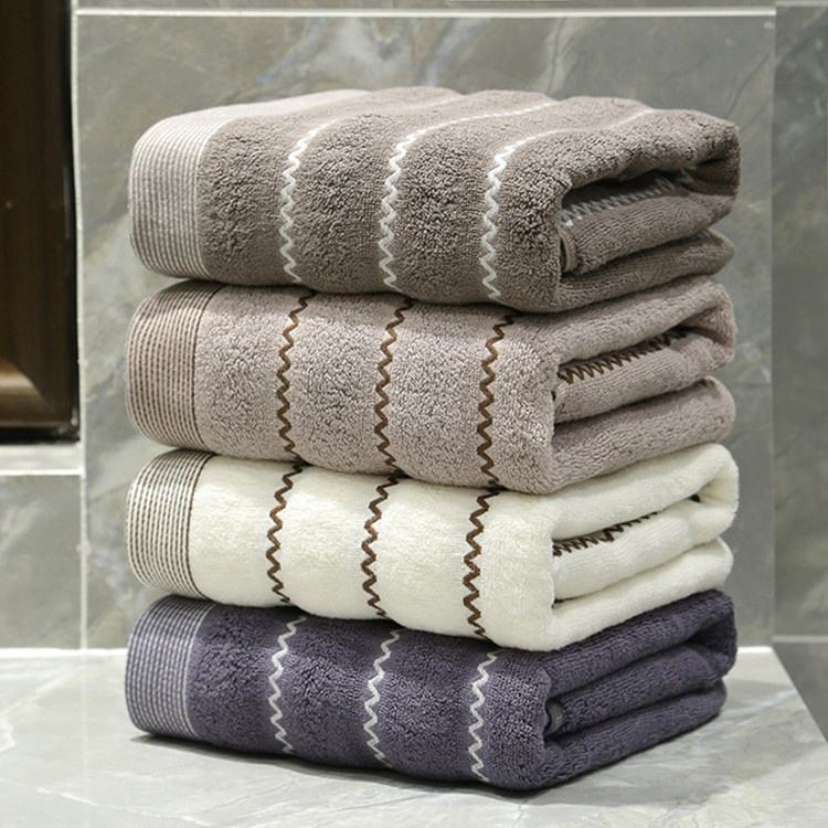 Cheap thin soft skin feeling washable Scotland stripe pattern design cotton terry home use bath towels household towel in bag