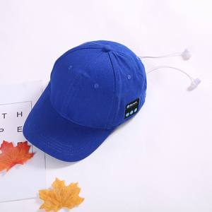 grey baseball wireless earphone with bluetooth headset connected hat