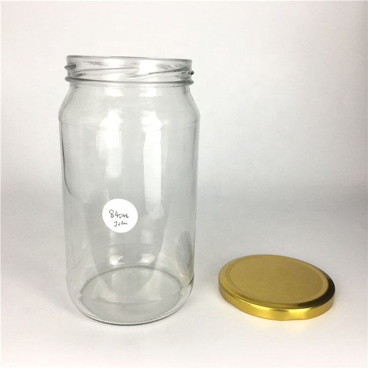 Wholesale 840ml empty round glass food storage jar for jam honey pickles jar with lid
