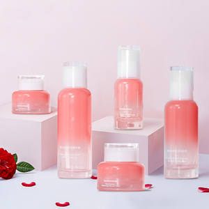 40ml 100ml 120ml Skin cares set packing pink unique empty lotion glass bottle and 30g 50g cosmetic cream jar set