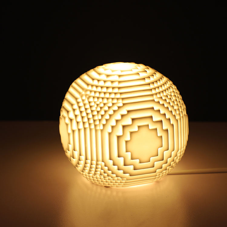 Geometric design unique handmade engrave white porcelain table night lamp for home decoration
