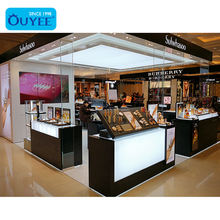 Mall Cosmetic Kiosk Acrylic Cosmetic Rack Glass Cosmetic Shop Counter Design Display Furniture Customized Makeup Kiosk