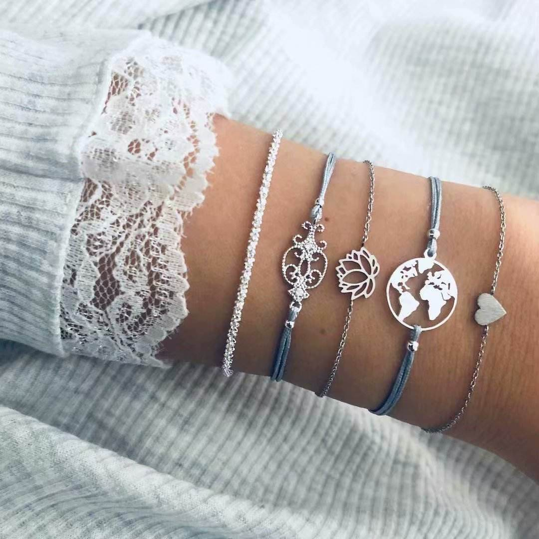 Hot new hollow lotus heart bracelet fashion world map woven bracelet five-piece set charm bracelet jewelry