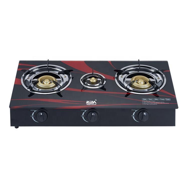 Venta caliente de color negro de hierro fundido quemador de mesa de vidrio templado panel tres 3 quemador de la estufa de gas