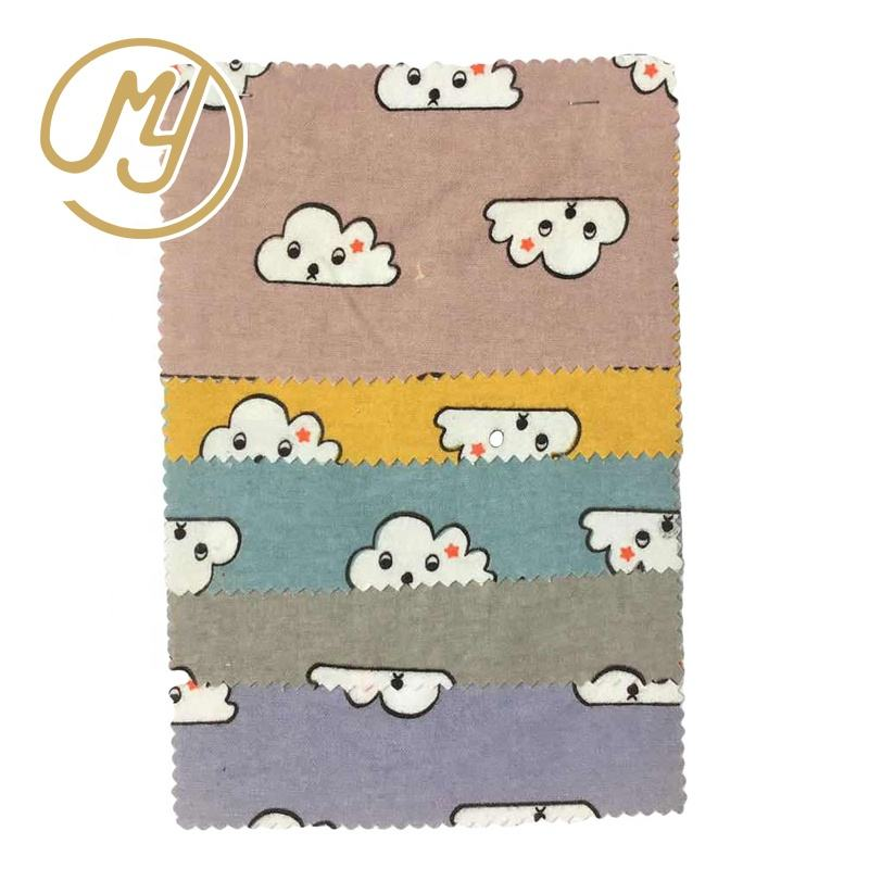 Hot selling stock wholesale plain woven dog printed cotton flannel fabric for children clothes