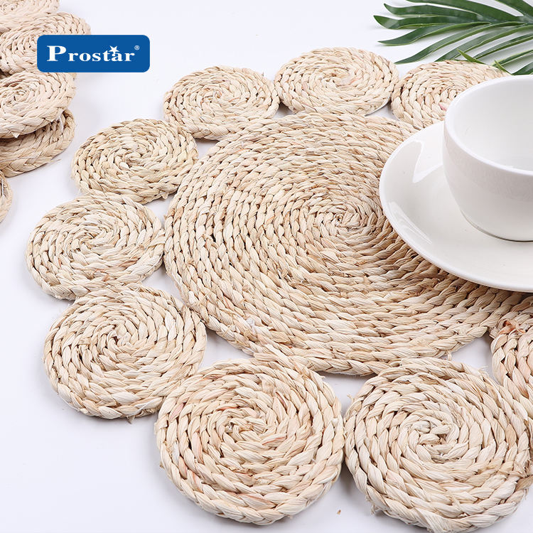 China wholesales natural corn bran weave placemat round braided rattan tablemats