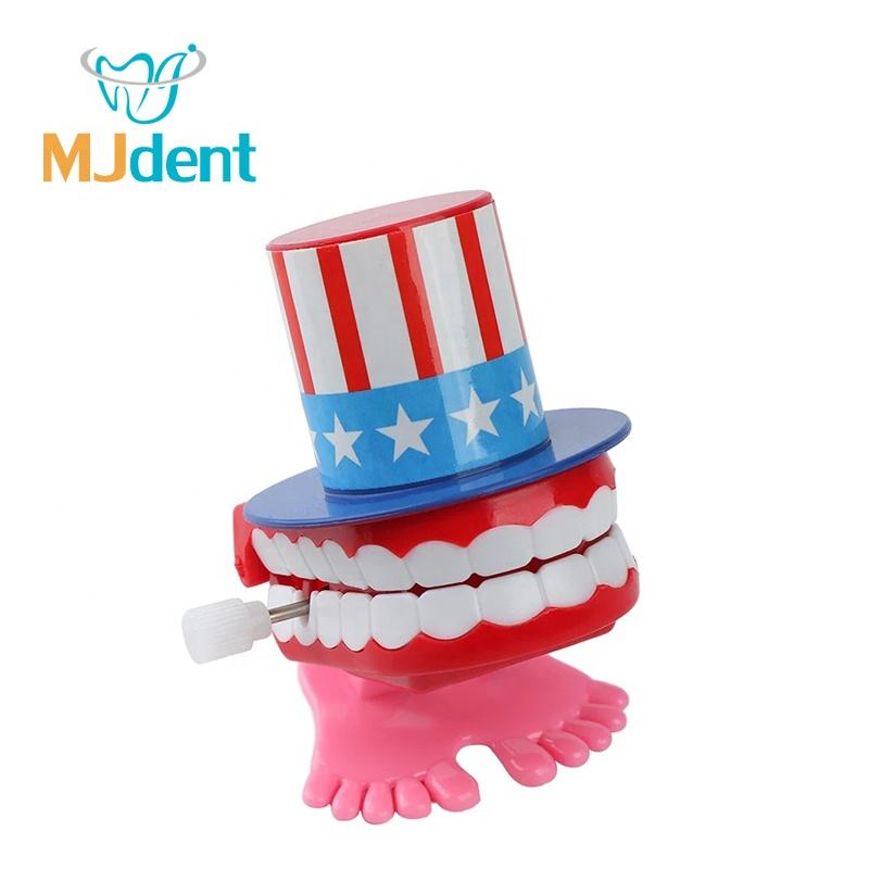 Cartoon plastic dental teeth toys cilinic gift jump teeth for kids
