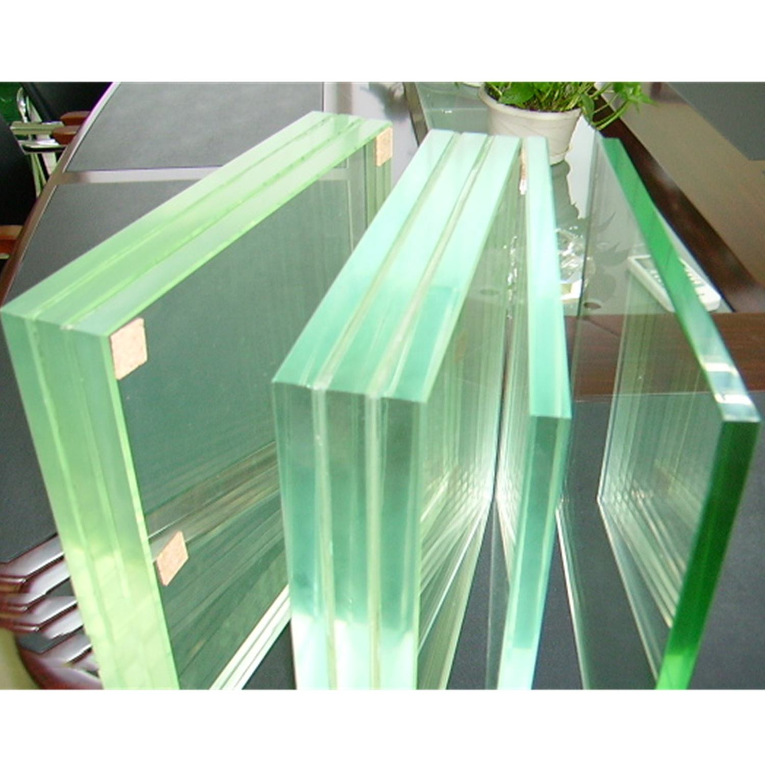 12mm Tempered Glass Laminated Glass Low Price 55.2 66.2 44.2 6.38 10.38 6 8 16 12 13.52 Mm Low Iron Polished Edge Tempered Triple Laminated Glass