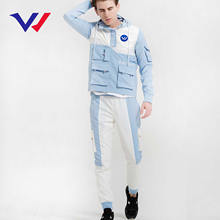 China autumn winter 2 piece 100% polyester embroidered rain tracksuit fabrics men windbreaker track custom jogging suit