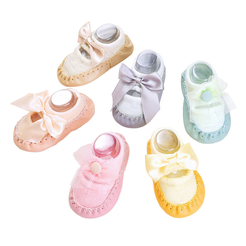 Customized cute bowknot cozy baby slipper socks with leather sole non slip wholesale