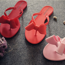 Wholesale bow jelly summer slippers female beach shoes solid flip flops jelly shoes