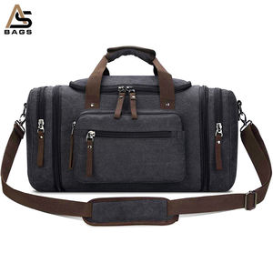 Guangzhou factory designer custom logo stock large black mens canvas sport gym travel duffel bag