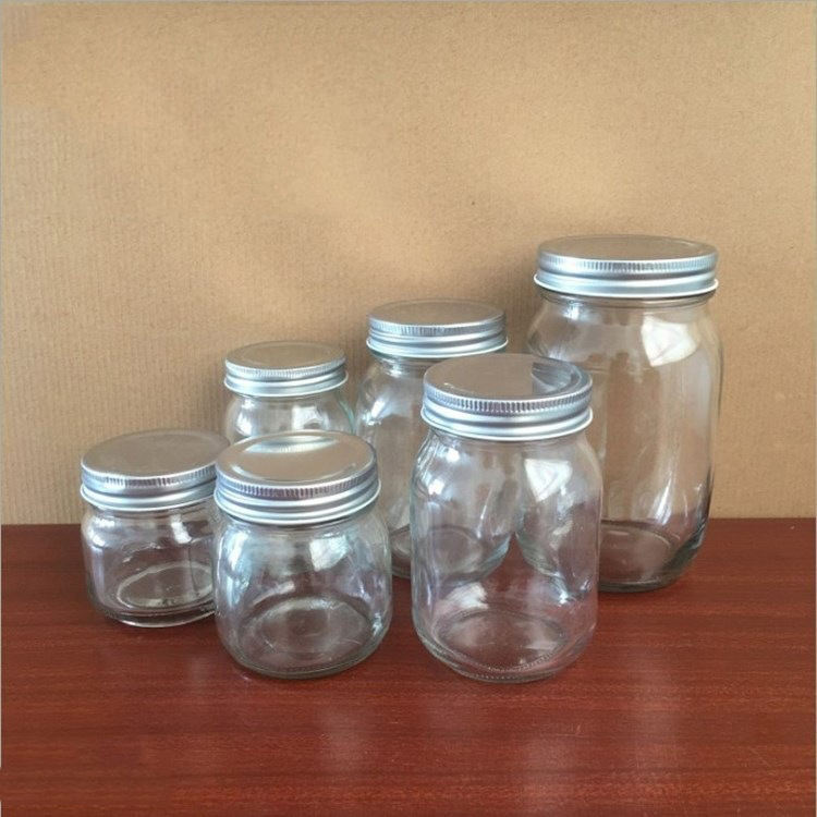 Wholesale cheap food storage empty honey bee glass jar for canning with metal lid