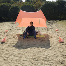 Customized portable  UV50 protect stretch beach shelter tent sunshade with sand anchor bag