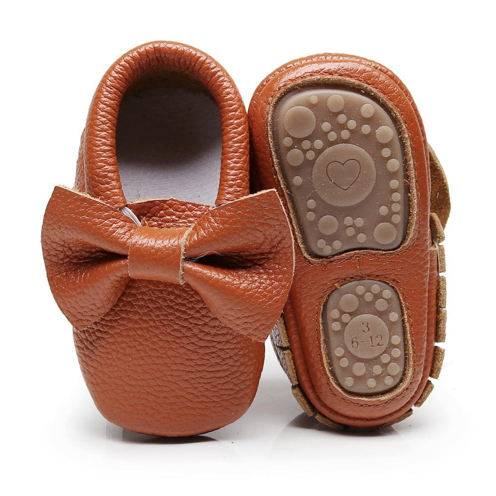 Factory wholesale Children's Stock Shoes Girls gold Leather Shoes Hard sole Children baby bow Moccasins