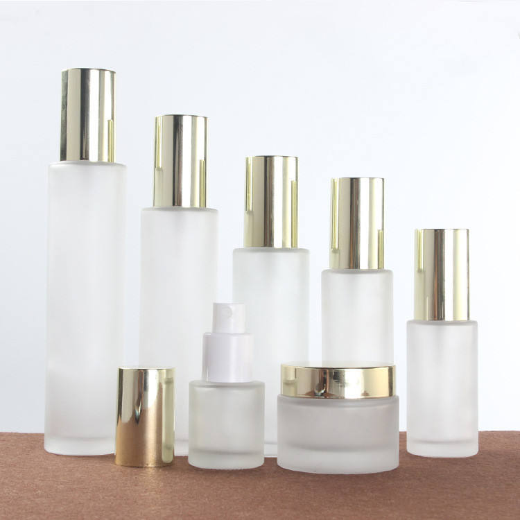 Wholesale package set 20ml to 120ml bottle 30g 50g jar glass cosmetic bottles and jars with light gold cap