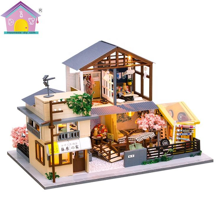 Miniature handmade wooden doll house for Friendship interaction