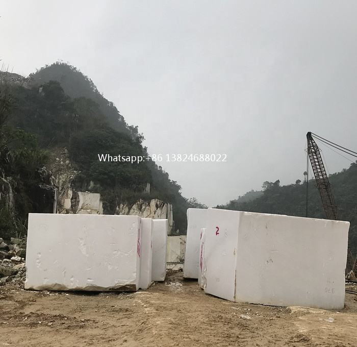 Pure white marble slabs and stone blocks cut to size from vietnam suppliers