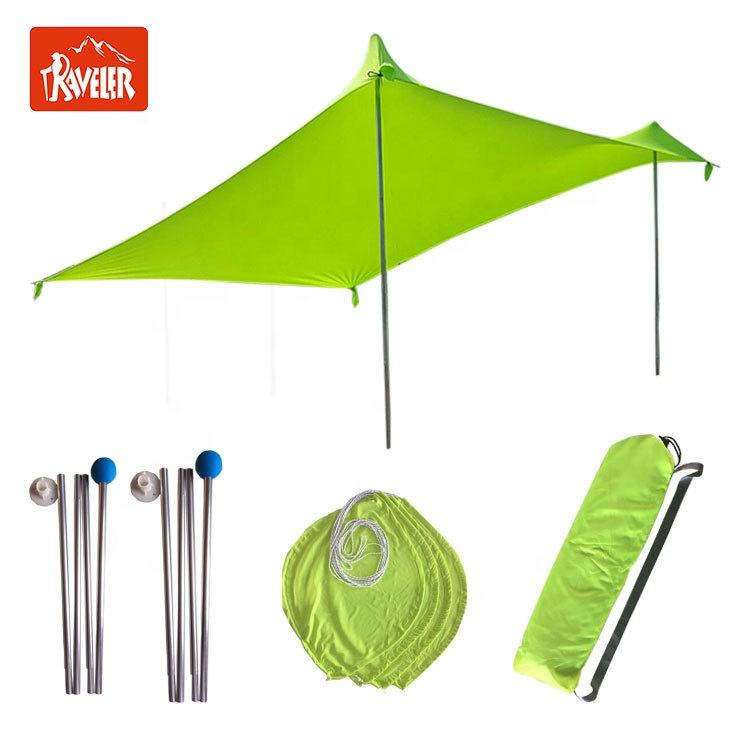 Sun Shelter And Ultralight Lycra Tent With Sandbags In Beach