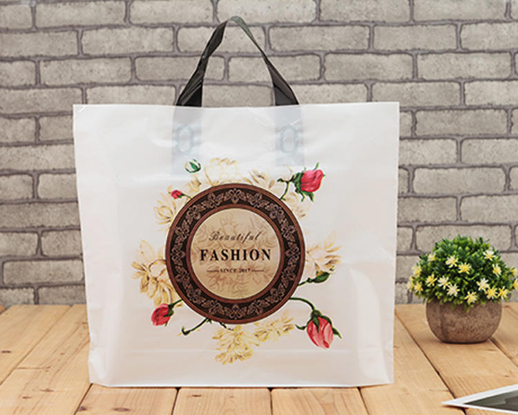 Yiwu wholesale color printing plastic die cut handle shopping bag