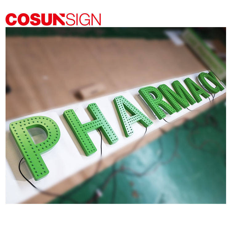 Punching machine processing LED pharmacy store cross sign