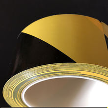 Black & yellow hazard warning safety tape with ultra self adhesive for floor marking