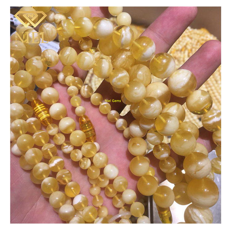 Hot sale high quality natural white and yellow baltic amber stone loose ball beads Niel Gems