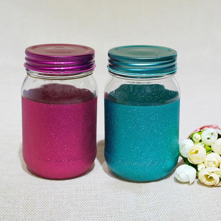 Mason jar with glitter design and colorful lid