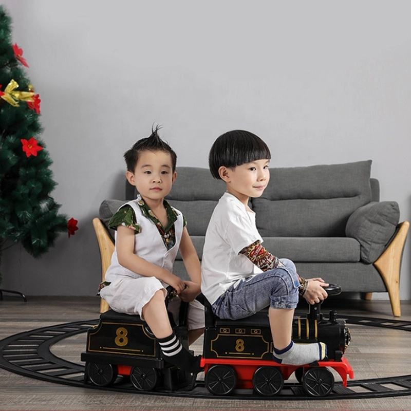 High quality carro a bateria para ninos Kids battery powered electric ride on toy train with tracks