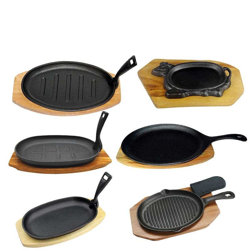 cast iron steak plate with wooden tray