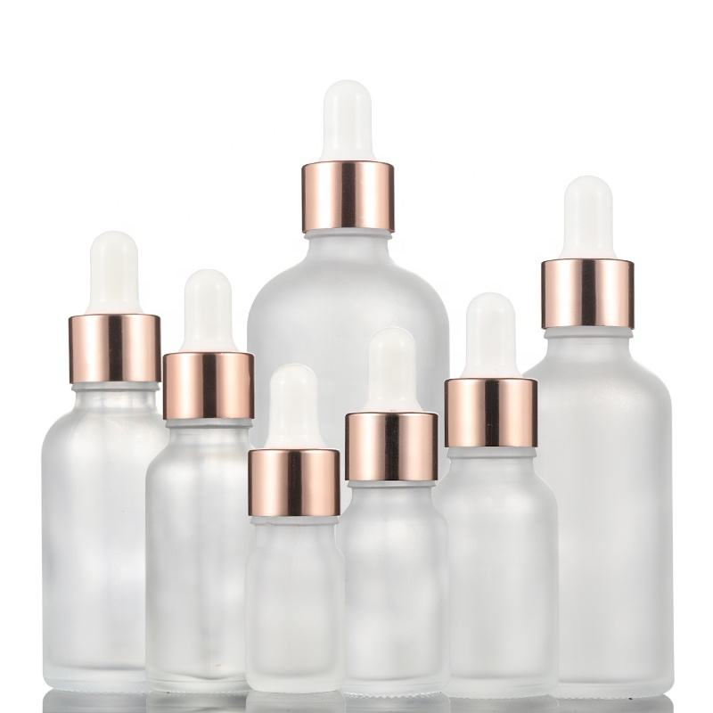 Essential oil bottle sets glass bottle with rose gold dropper cap empty cosmetic cuticle oil bottle for sale