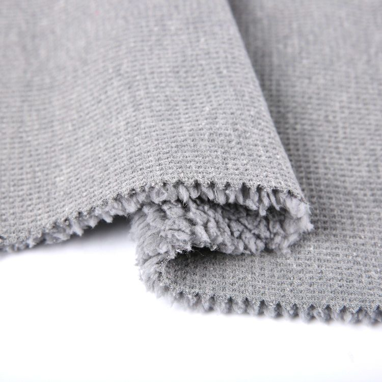 China custom wholesale CVC face waffle knit fabric bonded sherpa for outerwear