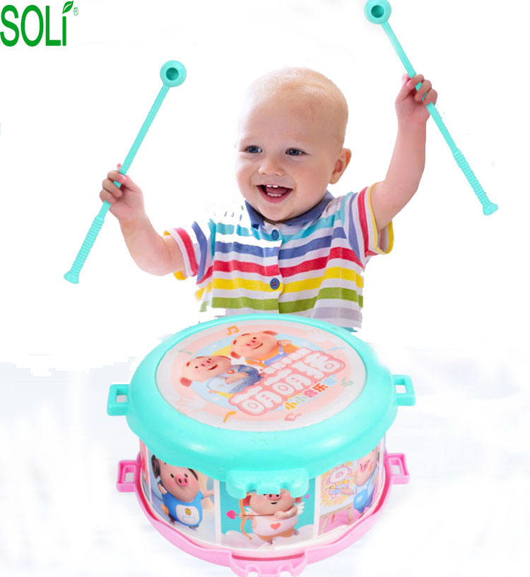 Early childhood cute children patting drums trumpet hand drum set