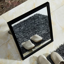 Black frame small stand floor mirror for shoe store