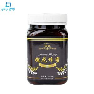 Made in china hot wholesale organic black bee honey in honey jar