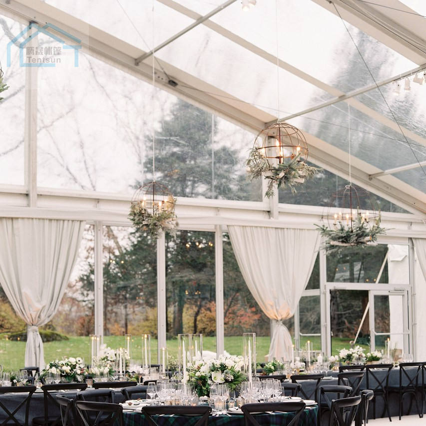 Bright transparent clear wedding tent against a backdrop of forest