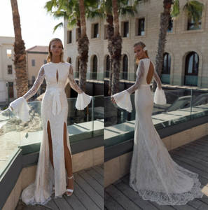 ZH1669Q sexy Side Split Mermaid Wedding Dresses Long flare Sleeves Lace applique Backless bow belt Boho beach Bridal Gowns Plus