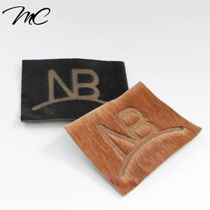 High quality custom new design horse hair leather labels/patches with laser logo for garment