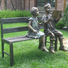 modern outdoor decoration bronze girl and boy reading on bench sculpture