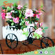small artificial potted mini flower with craft bicycle